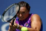 Jelena Jankovic of Serbia, returns a shot against Johanna Larsson of Sweden