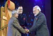 Prime Minister Narendra Modi shakes hands with President Pranab Mukherjee