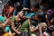 Crying relatives of the victims after a school bus was hit by a train at Masaipet in Medak