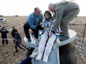 Russian space agency rescue team helps U.S. astronaut Kate Rubins to get from the capsule