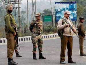 Army personnel and J&kK Police take position during encounter after militants attacked an Army camp in Nagrota