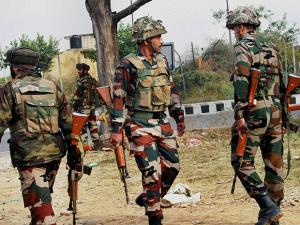 Army personnel take position during encounter after militants attacked an Army camp in Nagrota