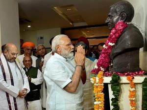 PM Narendra Modi paying tributes to the statue of Deendayal Upadhyay