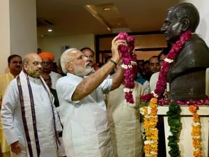 Prime Minister Narendra Modi paying floral tributes to the statue of Deendayal Upadhyay