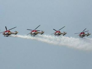 Sarang helicopters maneuvering their skill at the inauguration of 9th edition of Defexpo-16 in Panaji