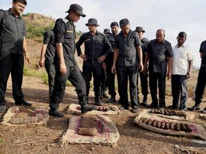The crime branch officials along with NSG commandos inspecting 51 live shells found in Thane