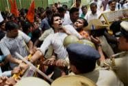 Police stop the members of ABVP who were trying to enter a school where a 6-year-girl was raped