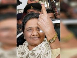 BSP supremo Mayawati shows her inked finger after casting her vote