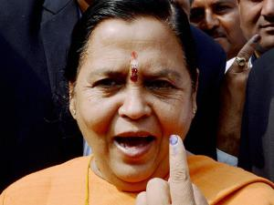 Union Water Resources Minister Uma Bharti  shows her inked finger after casting her vote