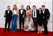 Aaron Paul, from left, Anna Gunn, Bryan Cranston, Betsy Brandt, Jesse Plemons, Laura Fraser and RJ Mitte pose in the press room with the award