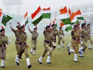 NCC women cadets run with national flags