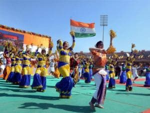 School children perform during a function organised at the Birsa Munda Football Stadium