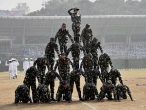 School children perform during the Republic Day parade at Chhatrasal Stadium