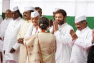 Congress President Sonia Gandhi greets party leaders after unfurling the national flag