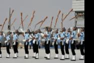 IAF personnel perform with their guns