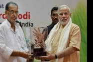 Prime Minister Narendra Modi is presented a memento from Union Agriculture Minister Radha Mohan Singh