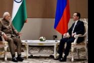 Prime Minister Narendra Modi with his Russian counterpart Dmitry Medvedev at a meeting