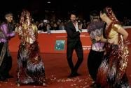 Actor Shahid Kapur, center, poses for photographers on the red carpet on the occasion of the screening of the movie Haider
