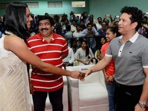 Cricket legend Sachin Tendulkar greets Rio Olympics silver medalist shuttler P V Sindhu