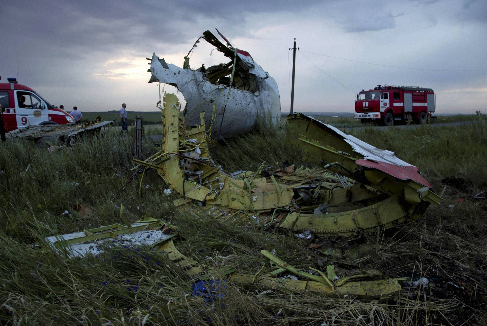 Fire engines, arrive, crash site, passenger plane, village of Hrabove, Ukraine, sun sets, Ukraine, carrying, 295 people, shot down, flew, country,  government, pro-Russia separatists, fighting, region denied, responsibility, downing, plane