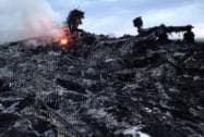 Smoke rises up at a crash site of a passenger plane, near the village of Grabovo Ukraine
