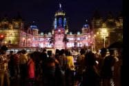People having a look of illuminated Chatrapati Shivaji Terminus on the eve of Independence Day
