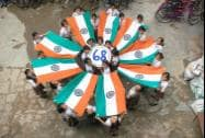 School girls celebrate with national flag on the eve of Independence day