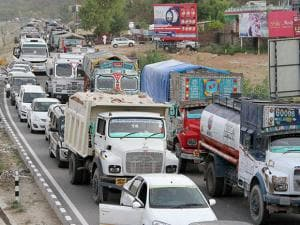 Stranded trucks and Vehicles on Jammu-Srinagar National Highway closed for traffic during a terrorist was killed in a gunbattle with CPRF jawans at a joint CRPF-Police camp in Kud area of Jammu
