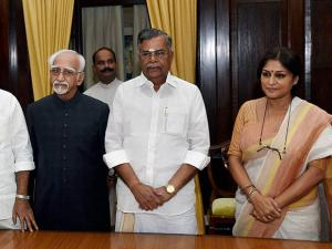 Hamid Ansari with newly inducted Rajya Sabha members L. Ganesan and Roopa Ganguly