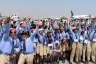 School kids enjoy during of the AERO India 2015