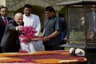 Afghanistan's President Ashraf Ghani showers rose petals to pay tributes at Mahatma Gandhi's memorial, Rajghat