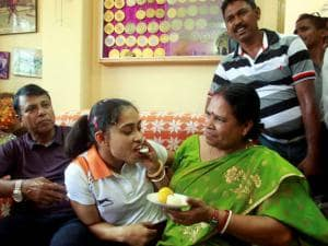 Gymnast Dipa Karmakar is offered sweets at her home in Agartala on Friday. Dipa Karmakar has become first Indian to qualify for the Olympics