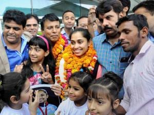 Gymnast Dipa Karmakar is welcomed upon her arrival at IGI airport in New Delhi