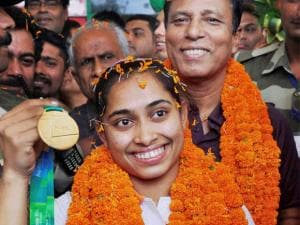 Gymnast Dipa Karmakar with her coach_Bisweswar Nandi being welcomed on her arrival at the airport in Agartala.