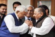 SP chief Mulayam Singh Yadav and RJD chief Lalu Prasad Yadav exchange greetings