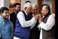 SP chief Mulayam Singh Yadav and RJD chief Lalu Prasad Yadav greets each other