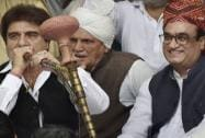 Congress leaders Raj Babbar smokes hookah as he sits with Ajay Maken