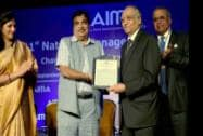Minister of Shipping, Road Transport and Highways, Nitin Gadkari with  Convention Chairman, Sudhir Jalan and Sr. Vice President AIMA H M Nerukar