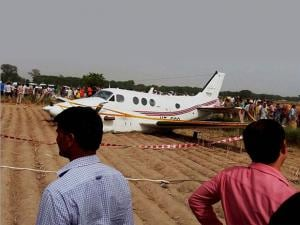 People looking at the air ambulance which crash landed at Kair village in Najafgarh area of Delhi on Tuesday. Seven people including a patient were on board during the mishap (2)