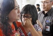 A relative of Air Asia flight QZ8501 passengers weep as she waits for the latest news on the missing