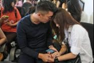 Relatives of the passengers of AirAsia flight QZ8501 comfort each other at Juanda International Airport in Surabaya