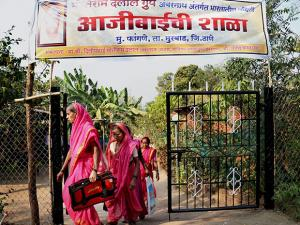 Elderly village women, all above 60 years age, entering a special school for grandmothers