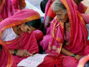 Elderly village women, all above 60 years age, seen learning Marathi at a special school for grandmothers