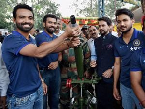 Ajinkya Rahane trying to know about the functioning of a mortar shell launcher as they spend time with the soldiers of 124 Sikh Battalion