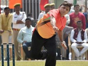 Pacer UP CM Akhilesh Yadav bowling during a cricket match between CM Eleven and IAS Eleven in Lucknow