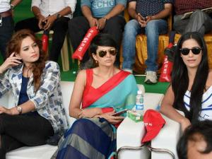 Television presenter Mandira Bedi (C) with models watch the CM Eleven and IAS Eleven cricket match in Lucknow