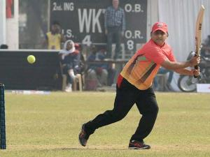 UP CM Akhilesh Yadav plays a shot during a cricket match between CM Eleven and IAS Eleven in Lucknow