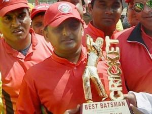UP CM Akhilesh Yadav with his award of 'best batsman' during a cricket match between CM Eleven and IAS Eleven in Lucknow