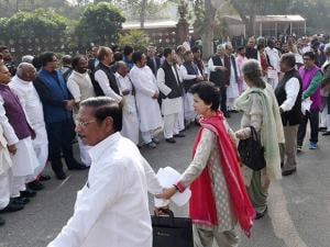 Opposition members form a human chain during a protest against the demonetization