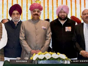 New Punjab Chief Minister Amarinder Singh and other ministers with Governor V P Singh Badnore after taking oath at the Raj Bhavan